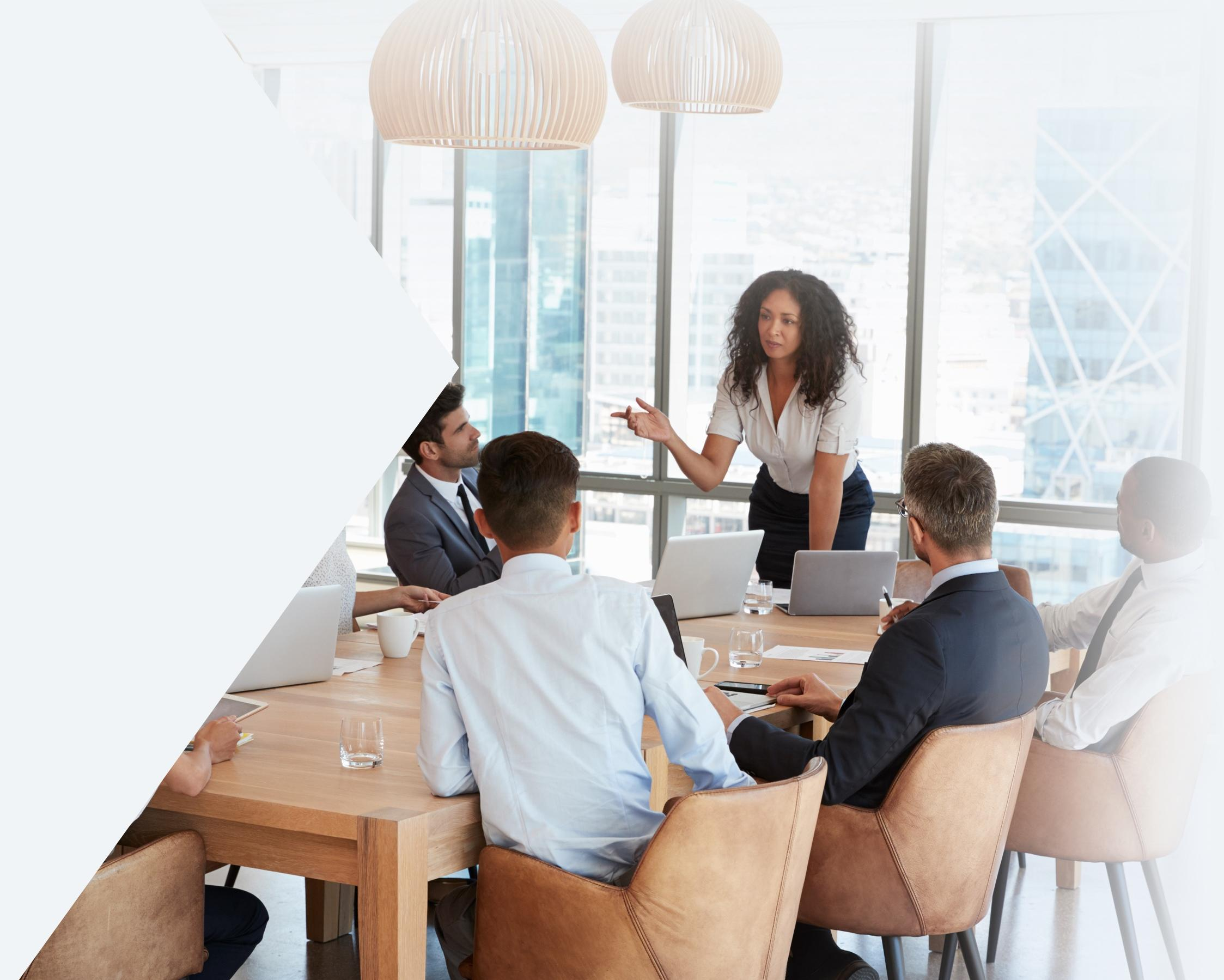 Business woman standing at a table and speaker to colleagues