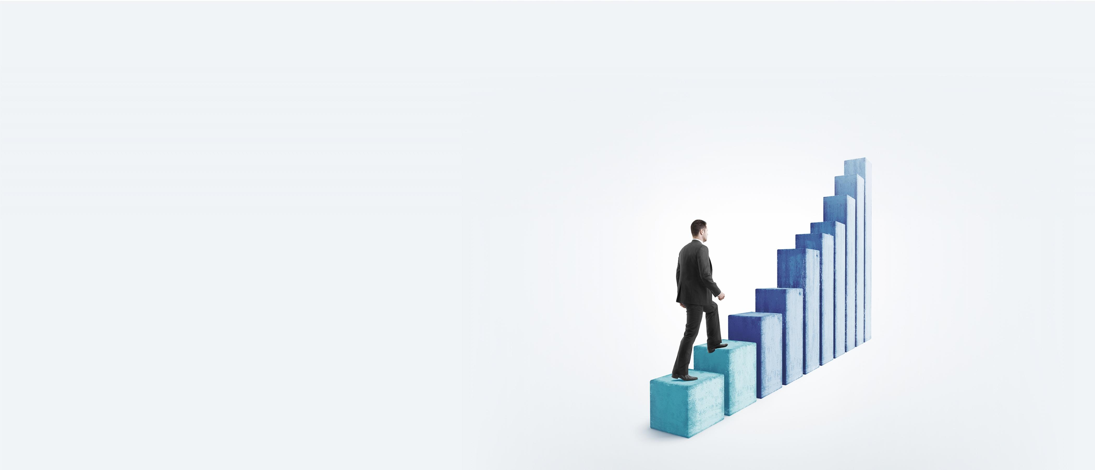 Business man ascending a 3-dimensional bar chart