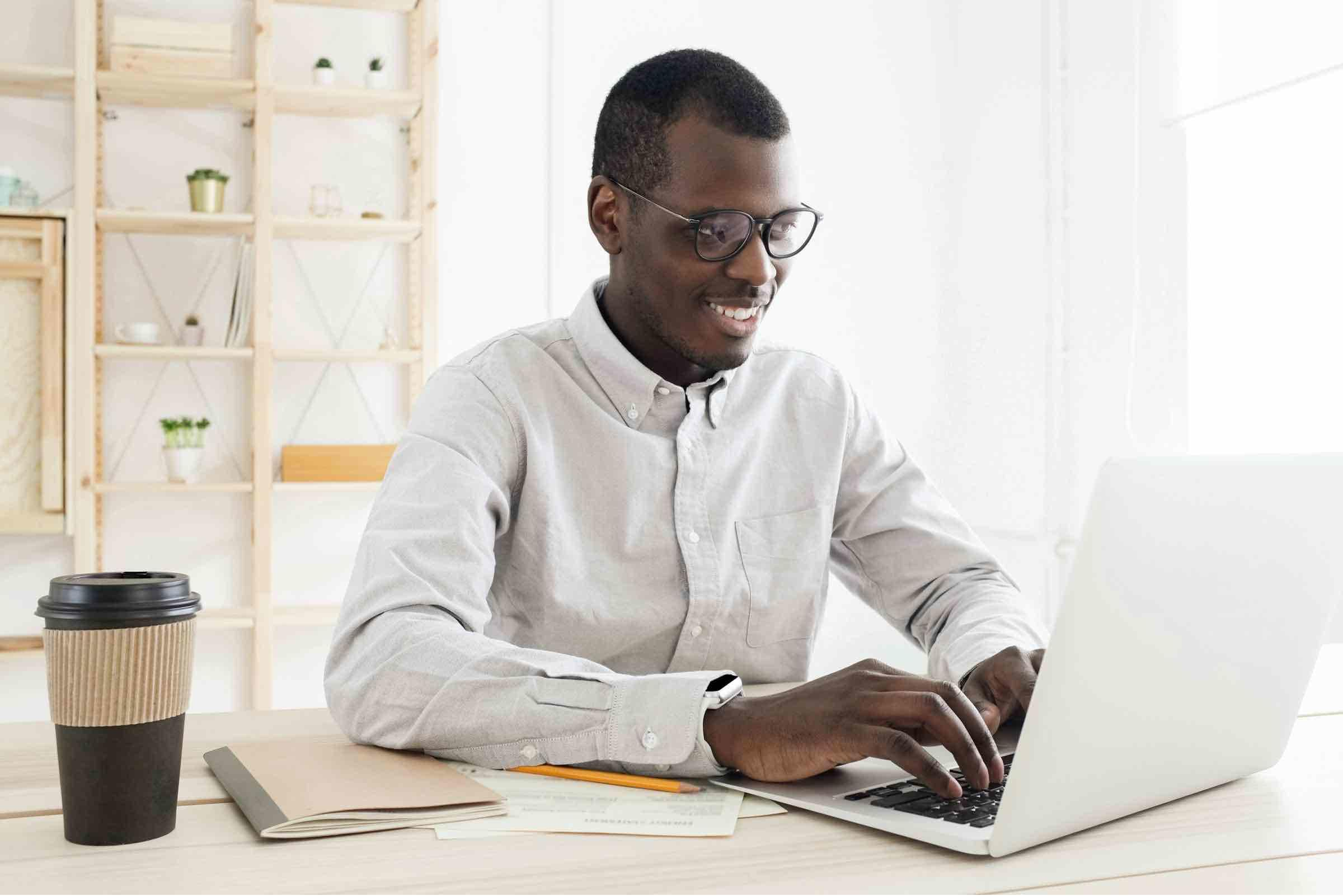 Businessman working from home on his laptop